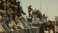 Iraqi government forces on tanks preparing to fight with the Islamic State in Fallujah