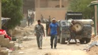 Iraqi government forces patrol the centre of the city of Fallujah on June 18 2016 as they hunt down holdout militants after retaking the DAESH's last...