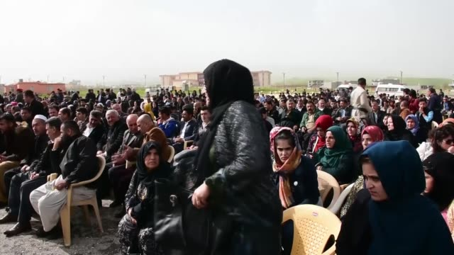 Iraqi Kurdish people attend a ceremony at the Monument of Halabja Martyrs to remember those who lost their lives in the Halabja chemical attack on...