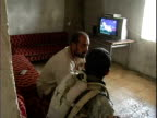Iraqi man talking with US Army soldier through interpreter about security issues / Mahmudiyah Iraq / AUDIO
