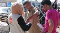 Iraqi men queue for food and hygiene kits at Debaga refugee camp where newly arrived refugees from Mosul have sought shelter as the ongoing offensive...