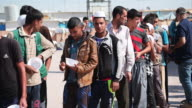 Iraqi men queue for food in Debaga refugee camp where newly arrived refugees from Mosul have sought shelter as the ongoing offensive to retake Mosul...