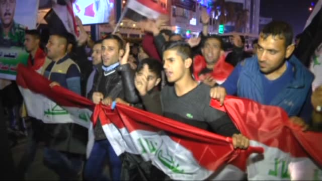 Iraqi people celebrate after Iraqi security forces retook Ramadi city from Daesh at Mansour district in Baghdad Iraq on December 28 2015