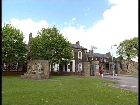 Investigation details GRANADA EXT ENGLAND Preston GV Fulwood Barracks Headquarters of the Queens Lancashire Regiment MS Union Flag blowing in wind GV...