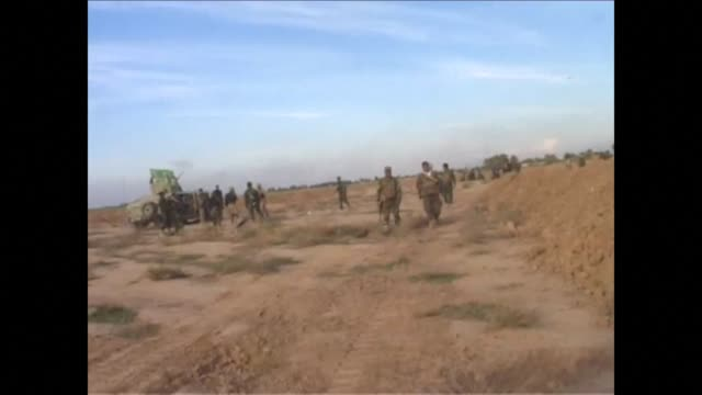Iraqi security forces and pro government fighters on Sunday retook areas from jihadists near the Iranian border in an operation that left 20 Kurdish...