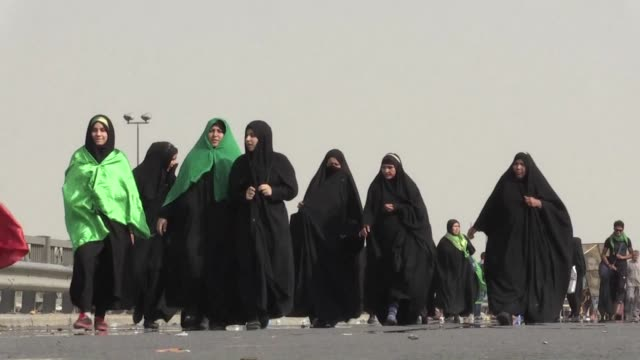 Iraqi Shiite worshippers started making their way to the holy city of Karbala along a street in Baghdad on Sunday
