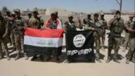 Iraqi troops police and special forces allied with the Hashed al Shaabi paramilitary coalition took control of all districts inside Tal Afar on...