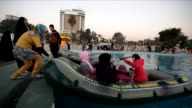 Iraqis gather at an amusement park in Baghdads Abu Nuwas street on February 4 2013 CLEAN Iraqis enjoy an amusement park on February 04 2013 in...
