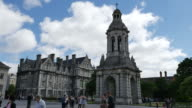 Ireland Dublin Trinity College with bell tower and students time lapse