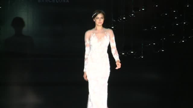 Irina Shayk walks the runway for Pronovias bridal collection during the 'Barcelona Bridal Fashion Week 2016' at Italian Pavilion of Fira Barcelona