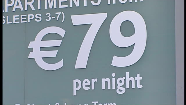 General views of Dublin REPUBLIC OF IRELAND Dublin ANGLE homeless man sitting on pavement as people walk past / Close up sign of hotel reading €79...