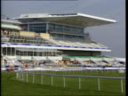 Irish horses to race in Grand National ENGLAND Liverpool Aintree EXT Empty grandstand at racecourse Racecourse worker filling in holes in course