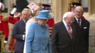 Irish President Michael D Higgins walking with Queen Elizabeth outside Windsor Castle