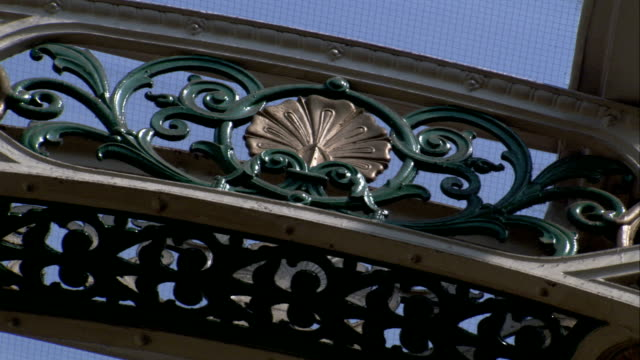 Iron scrolls adorn an arch in Leeds, England. Available in HD.