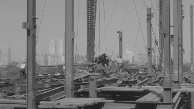 MS Iron workers working in under construction building on fifth floor (Enright building)
