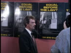 Nottingham CMS Trevor McAuley in front of press MS Press and McAuley CMS McAuley in front of press CMS Poster saying 'Equal before the law' CMS...