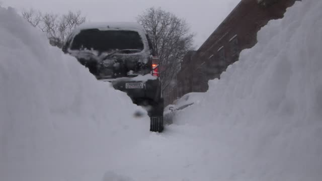 SUV is snowed in after heavy snow fall New York Available in HD