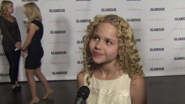 Isabella Acres on working with Zoe Saldana and Bradley Cooper and how she prepared for her role at the 2011 Glamour Reel Moments Premiere Presented...