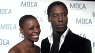 Isaiah Washington and wife Jenisa Marie on the exhibit on the marriage of fashion and design and on MOCA at the Skin Bones Exhibit arrivals at the...