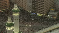 Islamic pilgrims surge into the city of Mecca and surround the sacred site of Kaaba.