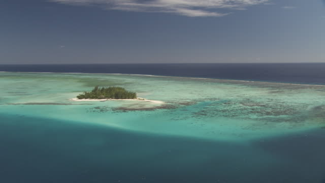 Island and reef in shallow tropical lagoon, Maupiti, French Polynesia