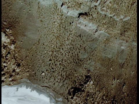 Islands of rock sticking out of vast salt lake Bolivia.