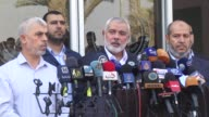 Ismail Haniyeh the chief of Hamas' political bureau speaks at a press conference upon his arrival at the Rafah border crossing returning from Cairo...