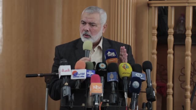 Ismail Haniyeh the chief of Hamas' political bureau speaks during the funeral ceremony of Palestinian fighters Arafat Abu Morshed Hassan Abu Hassanin...