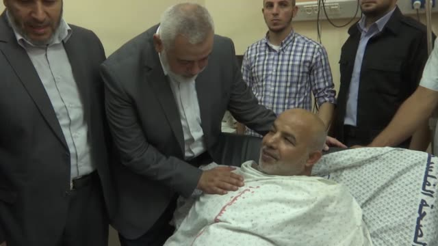 Ismail Haniyeh the chief of Hamas' political bureau visits Tawfiq Abu Naim after he was injured when a bomb planted in his car exploded following...