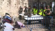 Israel reopens an ultra sensitive holy site closed after an attack that killed two policemen though Muslim worshippers were on Sunday refusing to...