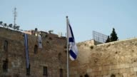 Israeli Flag waving over the Wailing Wall