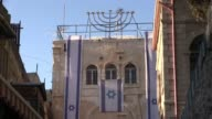 Israeli flags hanging from Beit Wittenberg also known as Sharon's House which is the center of a sizeable Jewish community that lives in el Wad...