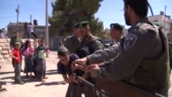 Israeli forces on Wednesday evicted a group of settlers from a disputed house in the West Bank city of Hebron a day after they were ordered to leave...