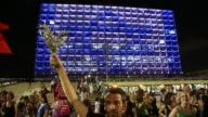 Israeli left wing demonstrators take to the streets of Tel Aviv to protest against Israels military operations in the Gaza strip