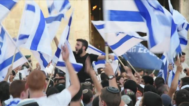 Israeli nationalists and police clashed with Palestinians in occupied east Jerusalem on Sunday as crowds of Jewish hardliners marched across the city...
