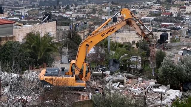 Israeli police demolished Wednesday a house belonging to a Palestinian family in the Arab eastJerusalem neighbourhood of Shuafat with authorities...
