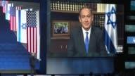 Israeli Prime Minister Benjamin Netanyahu addresses the AIPAC lobby group's annual conference live via satellite from Jerusalem