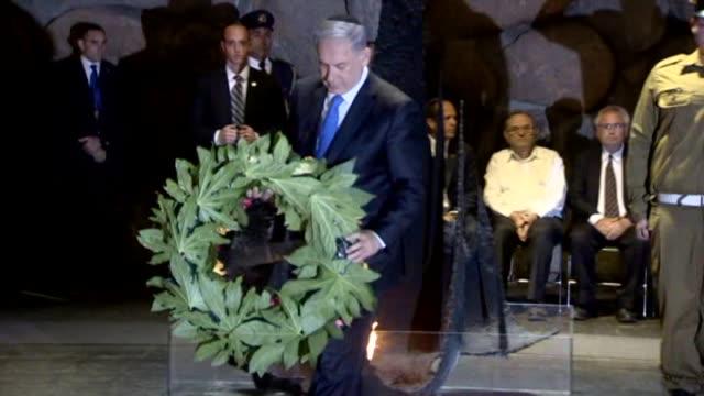 Israeli Prime Minister Benjamin Netanyahu and President Reuven Rivlin place wreaths near the Eternal Flame inside Yad Vashem memorial Israel's...