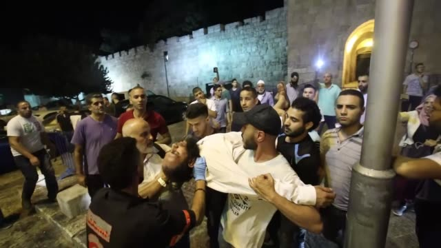 Israeli security forces clash with Palestinian demonstrators including AlAqsa Mosque imam Sheikh Ikrima Sabri who perform Isha prayer outside the...