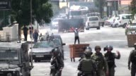 Israeli security forces clash with Palestinian protesters following a protest against Israeli restrictions on access to AlAqsa Mosque on July 24 2017...