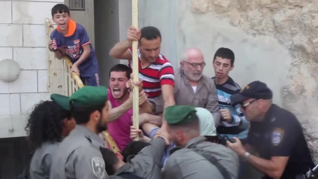 Israeli security forces clash with Palestinians in front of the Abu Rajab family house where dozens of Israeli students gather to support settlers...