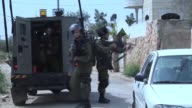 Israeli security forces intervene Palestinian protestors during a protest against the construction of Jewish settlement housing and the separation...