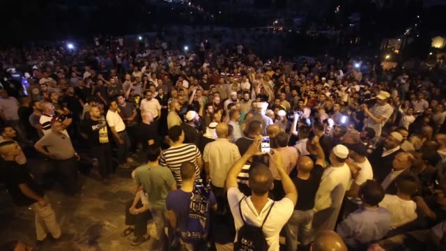 Israeli security forces use tear gas and stun grenade on Palestinians who gathered to perform the evening prayer in front of the Lion's Gate at Al...