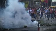 Israeli security forces use tear gas to disperse Palestinian protesters during a protest against the Israeli violations in Ramallah West Bank on...