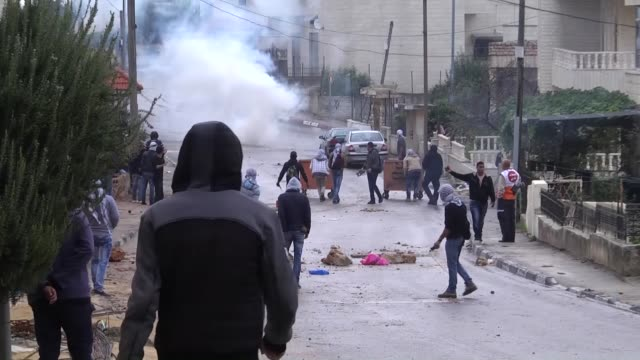 Israeli soldiers clash with Palestinians who protest Israeli government's violations on Jerusalem and West Bank near the Jewish settlement of Psagot...