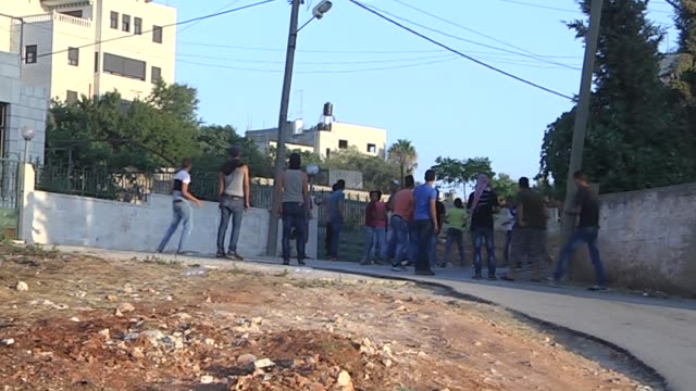 Israeli soldiers intervene the Palestinian protestors near AlJalzoon refugee camp in Ramallah West Bank on August 1 following the funeral of...