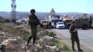 Israeli soldiers prevent Palestinians from entering Bir Nabala village in Jerusalem on November 28 2015