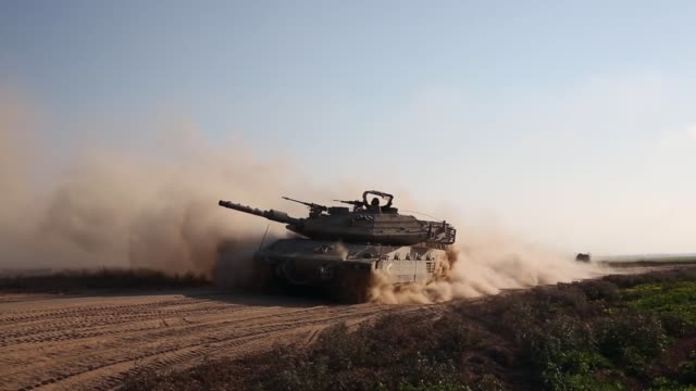 PAN Israeli tank driving down a road 42 Israeli soldiers and over 1000 Palestinians have been killed as the Israeli operation 'Protective Edge' nears...