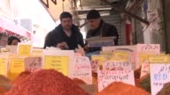 Israelis shop at open air market it in Israel vendor sells spices