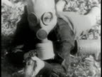 Italian Boy Scouts laying on grass putting on gas masks MS Boy scout in gas mask w/ rifle VS Gas masked boy scouts w/ rifles rushing field instructor...